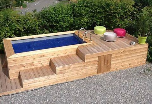 this is a whole big set up created with the wooden pallets this seems like a recreational place set in the garden of some huge house whole deck is