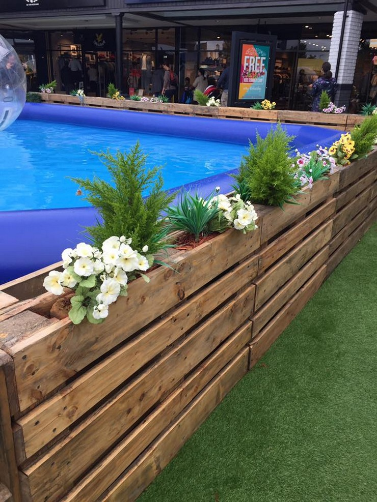 pallet planters around pool
