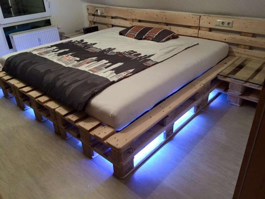 giant wooden pallet bed with lights