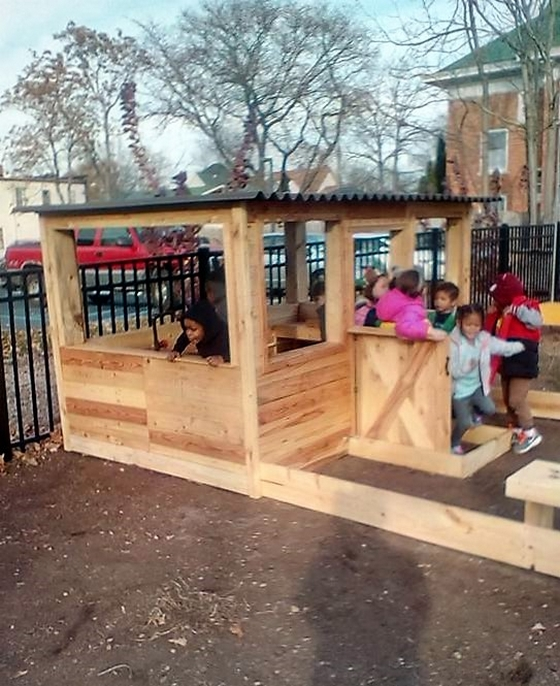 kids-fun-with-pallet-playhouse